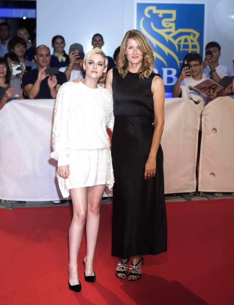 "TORONTO, Sept. 16, 2018 - Actresses Kristen Stewart (L) and Laura Dern pose for photos before the world premiere of the closing film  ""Jeremiah Terminator Leroy"" at Roy Thomson Hall during ... - Kristen Stewart"