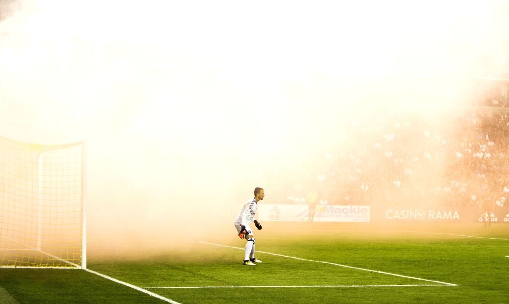 TORONTO, Sept. 21, 2017 - Goalkeeper Evan Bush of Montreal Impact is seen among the smoke during the 2017 Major League Soccer (MLS) match against Toronto FC at BMO Field in Toronto, Canada, Sept. 20, ...