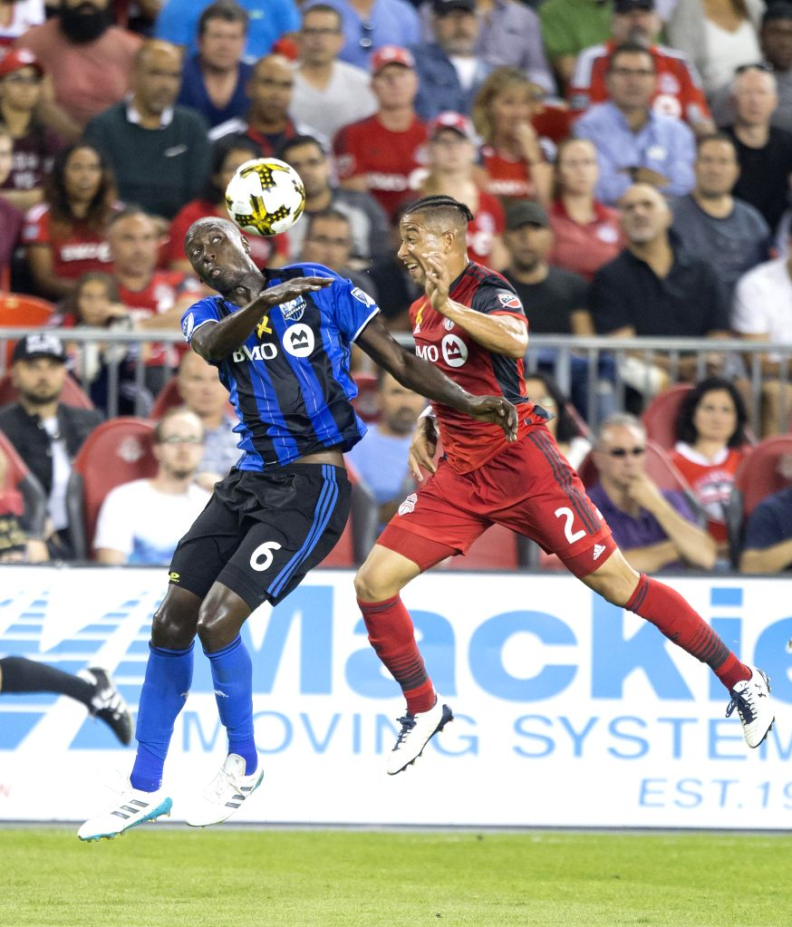 TORONTO, Sept. 21, 2017 - Justin Morrow (R) of Toronto FC vies with Hassoun Camara of Montreal Impact during their 2017 Major League Soccer (MLS) match at BMO Field in Toronto, Canada, Sept. 20, ...