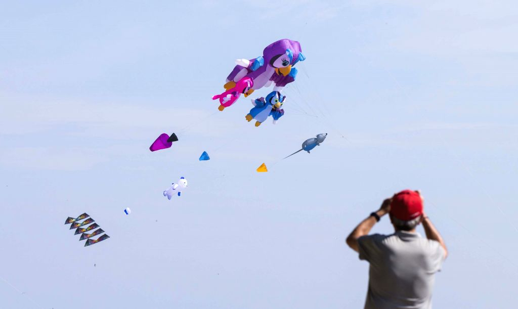 TORONTO, Sept. 22, 2019 - A man takes photos of flying kites during the 2019 Toronto WindFest Fun Fly at Woodbine Beach in Toronto, Canada, on Sept. 22, 2019. Hundreds of kite fliers showed the ...