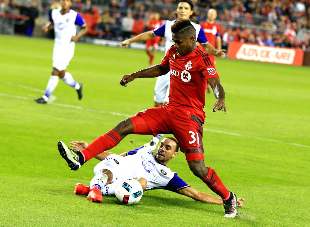 TORONTO, Sept. 29, 2016 - Armando Cooper(top) of Toronto FC competes during the 2016 Major League Soccer (MLS) match against Orlando City SC in Toronto, Canada, Sept. 28, 2016. The match ended in a ...