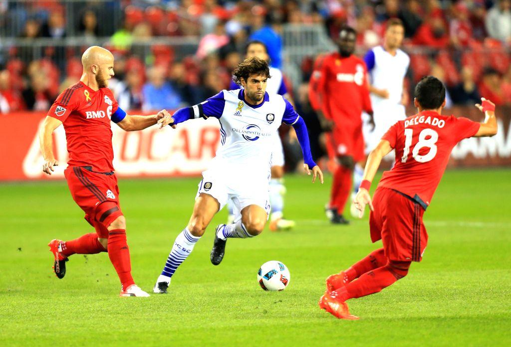 TORONTO, Sept. 29, 2016 - Kaka (C) of Orlando City SC breaks through during the 2016 Major League Soccer (MLS) match in Toronto, Canada, Sept. 28, 2016. The match ended in a 0-0 draw.