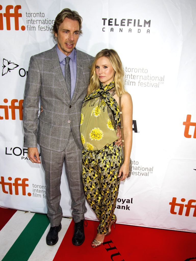 "Actor Dax Shepard and his wife Kristen Bell pose for photos before the premiere of the opening film ""The Judge"" at Roy Thomson Hall during the 39th ... - Dax Shepard"
