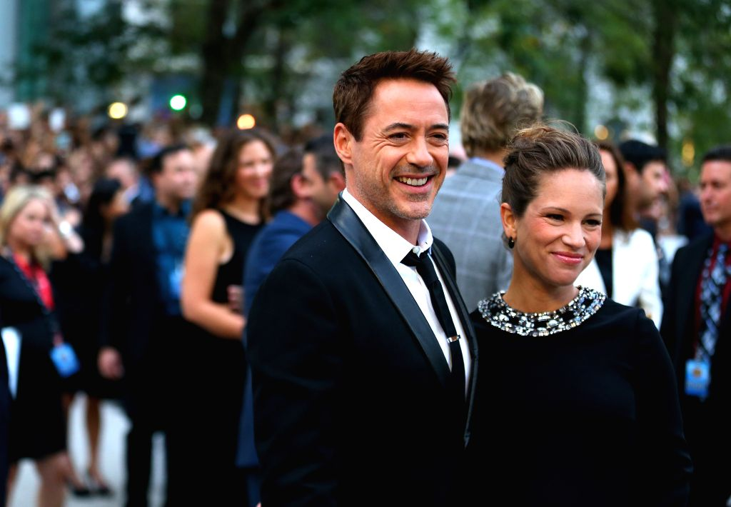 "Actor Robert Downey Jr. and his wife Susan Downey arrive for the premiere of the opening film ""The Judge"" at Roy Thomson Hall during the 39th Toronto ... - Robert Downey J"