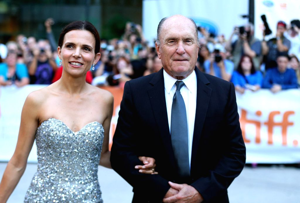 "Actor Robert Duvall and his wife Luciana Pedraza arrive for the premiere of the opening film ""The Judge"" at Roy Thomson Hall during the 39th Toronto ... - Robert Duvall"