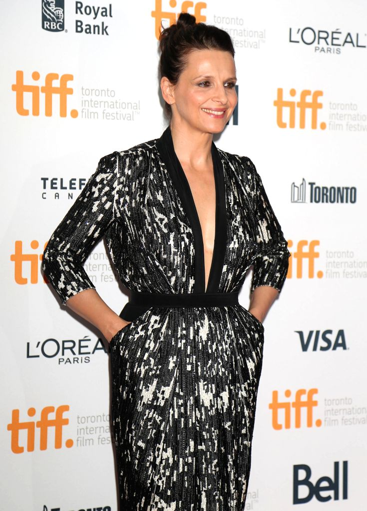 "Actress Juliette Binoche poses for photos before the screening of the film ""Clouds Of Sils Maria"" at Princess of Wales Theatre during the 39th Toronto ... - Juliette Binoche"