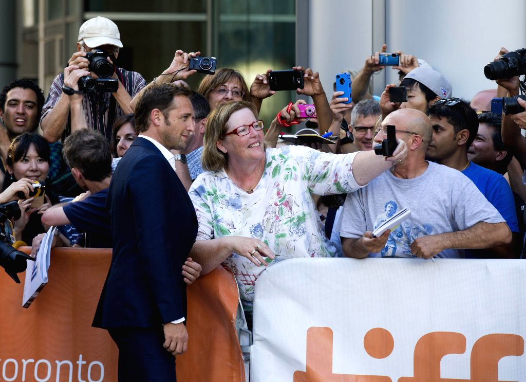 "Actor Josh Lucas poses for photos with fans before the premiere of the film ""Boychoir"" at Roy Thomson Hall during the 39th Toronto International Film ... - Josh Lucas"