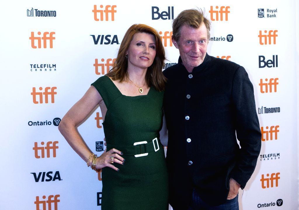 """TORONTO, Sept. 6, 2019 - Actress Sharon Horgan (L) and actor Jason Flemyng pose for photos before the world premiere of the film """"Military Wives"""" at Elgin Theater during the 2019 Toronto ... - Sharon Horgan"""