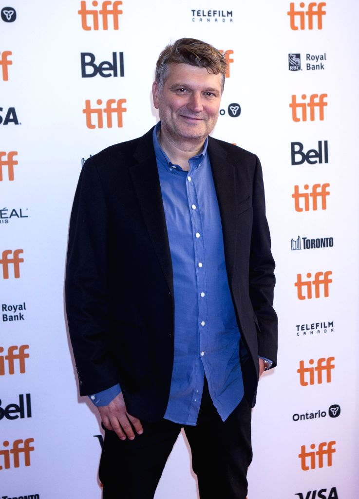 """TORONTO, Sept. 6, 2019 - Director Peter Cattaneo poses for photos before the world premiere of the film """"Military Wives"""" at Elgin Theater during the 2019 Toronto International Film Festival ..."""