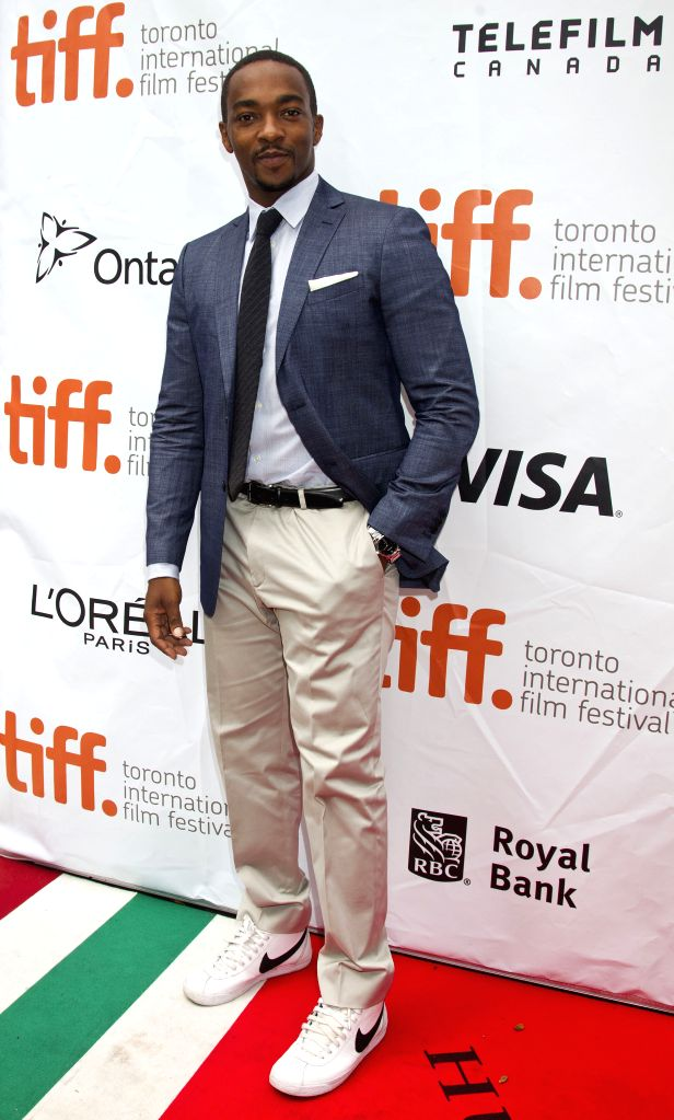 "Actor Anthony Mackie poses for photos before the premiere of the film ""Black And White"" at Roy Thomson Hall during the 39th Toronto International Film ... - Anthony Mackie"