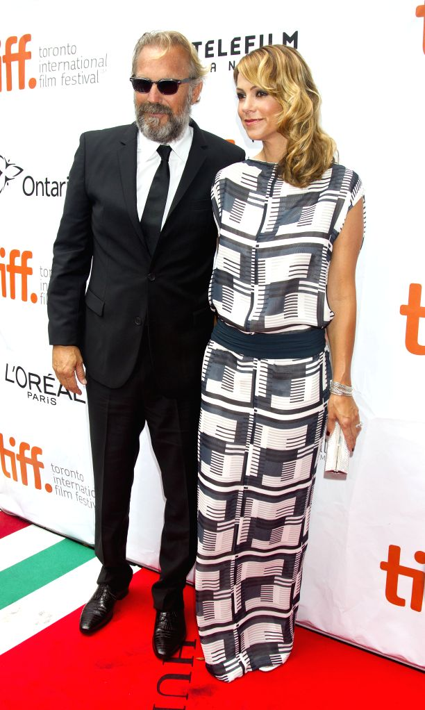 "Actor Kevin Costner (L) and his wife Christine Costner pose for photos before the premiere of the film ""Black And White"" at Roy Thomson Hall during the ... - Kevin Costner"