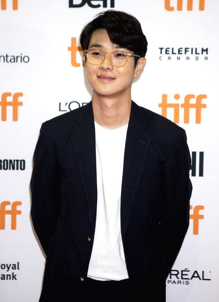 "TORONTO, Sept. 7, 2019 - Actor Choi Woo-shik poses for photos before the Canadian premiere of the film ""Parasite"" at Ryerson Theatre during the 2019 Toronto International Film Festival ... - Choi Woo"