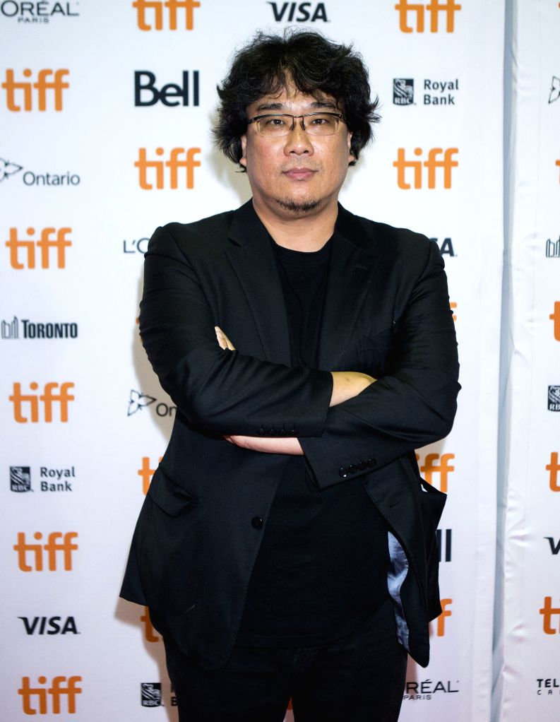"TORONTO, Sept. 7, 2019 - Director Bong Joon-ho poses for photos before the Canadian premiere of the film ""Parasite"" at Ryerson Theatre during the 2019 Toronto International Film Festival ..."