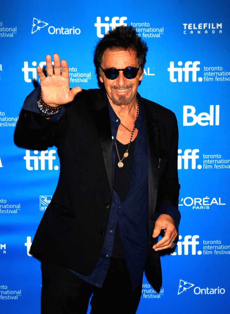 "Actor Al Pacino poses for photos at the press conference of the film ""Manglehorn"" during the 39th Toronto International Film Festival in Toronto, Canada, ."