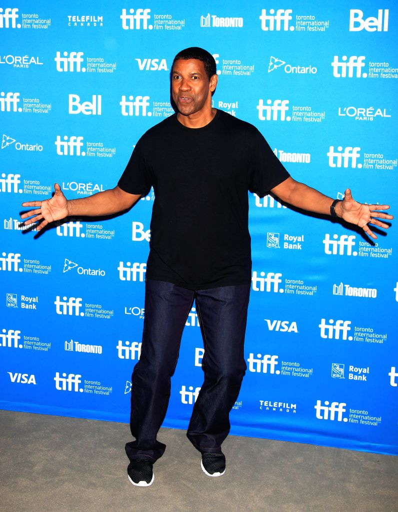 "TORONTO, Sept. 8, 2014 (Xinhua) -- Actor Denzel Washington poses for photos at the press conference of the film ""The Equalizer"" during the 39th Toronto International Film Festival in Toronto, Canada, Sept. 7, 2014. (Xinhua/Zou Zheng/IANS) - Denzel Washington"