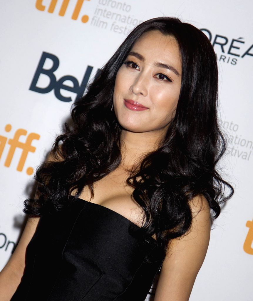 "Actress Ma Su poses for photos before the premiere of the film ""Breakup Buddies"" at Princess of Wales Theatre during the 39th Toronto International Film .."