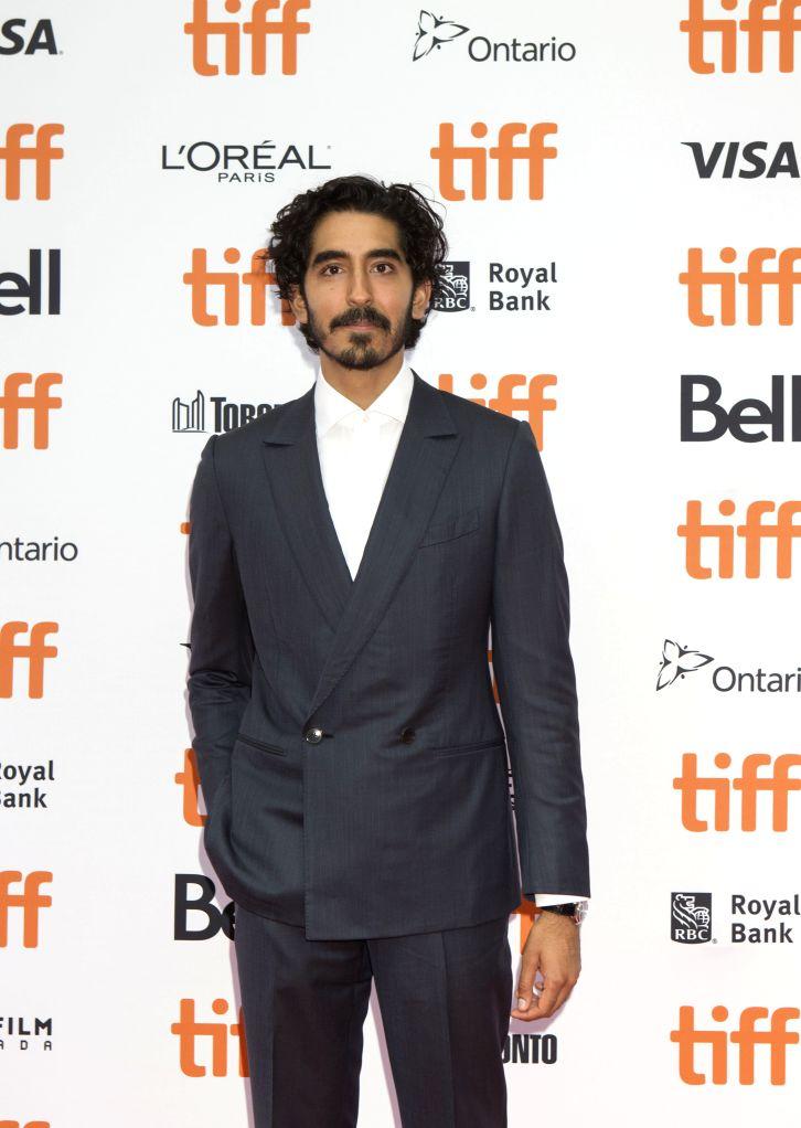 "TORONTO, Sept. 8, 2018 - Actor Dev Patel poses for photos before the premiere of the film ""Hotel Mumbai"" during the 2018 Toronto International Film Festival in Toronto, Canada, Sept. 7, ... - Dev Patel"