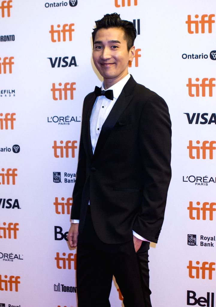 "TORONTO, Sept. 8, 2019 - Actor Mark Chao poses for photos before the North American premiere of the film ""Saturday Fiction"" at Winter Garden Theatre during the 2019 Toronto International ... - Mark Chao"