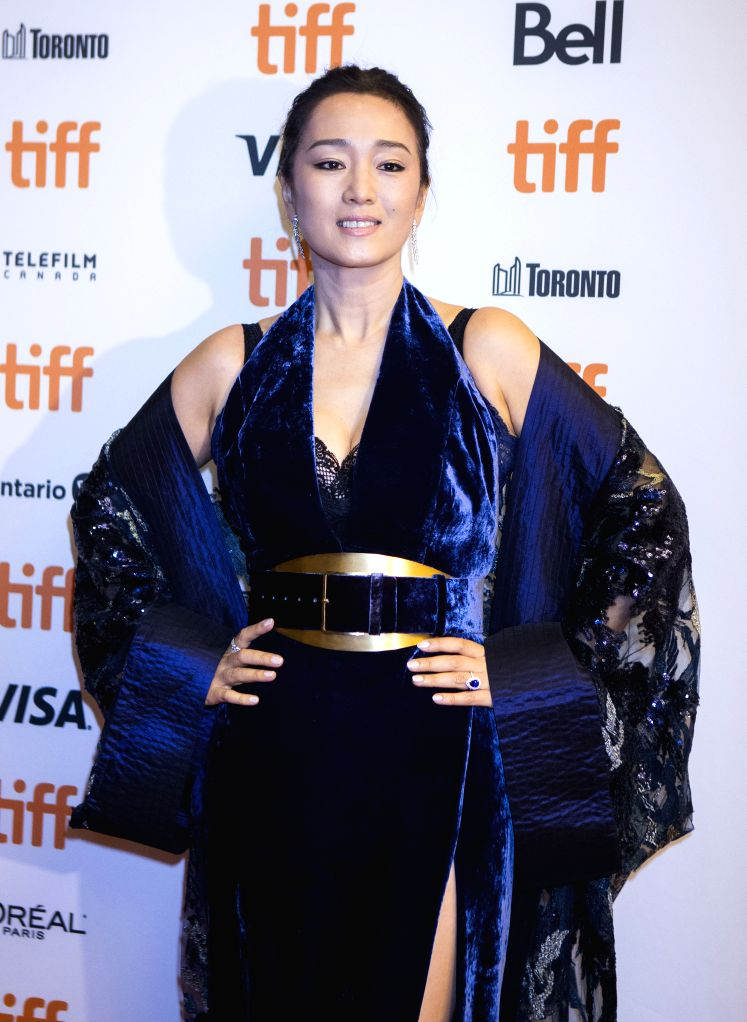 "TORONTO, Sept. 8, 2019 - Actress Gong Li poses for photos before the North American premiere of the film ""Saturday Fiction"" at Winter Garden Theatre during the 2019 Toronto International ... - Gong L"