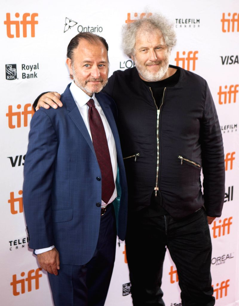 """TORONTO, Sept. 8, 2019 - Directors Fisher Stevens (L) and Malcolm Venville pose for photos prior to the world premiere of the film """"And We Go Green"""" at the Ryerson Theater during the 2019 ..."""