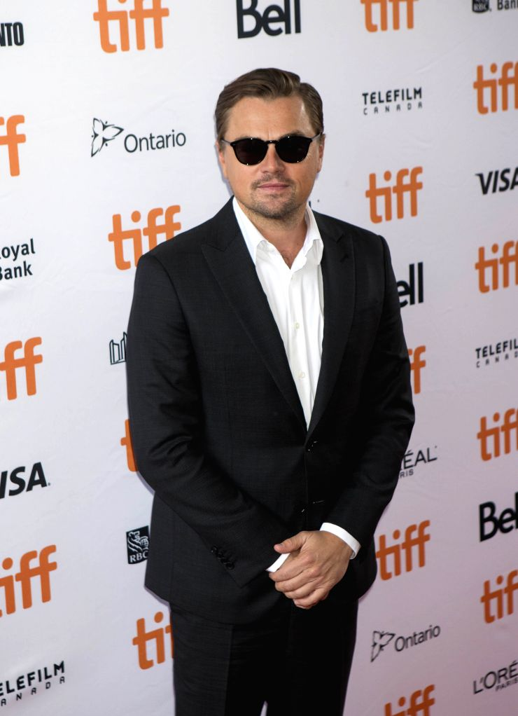 """TORONTO, Sept. 8, 2019 - Producer Leonardo DiCaprio poses for photos prior to the world premiere of the film """"And We Go Green"""" at the Ryerson Theater during the 2019 Toronto International ..."""