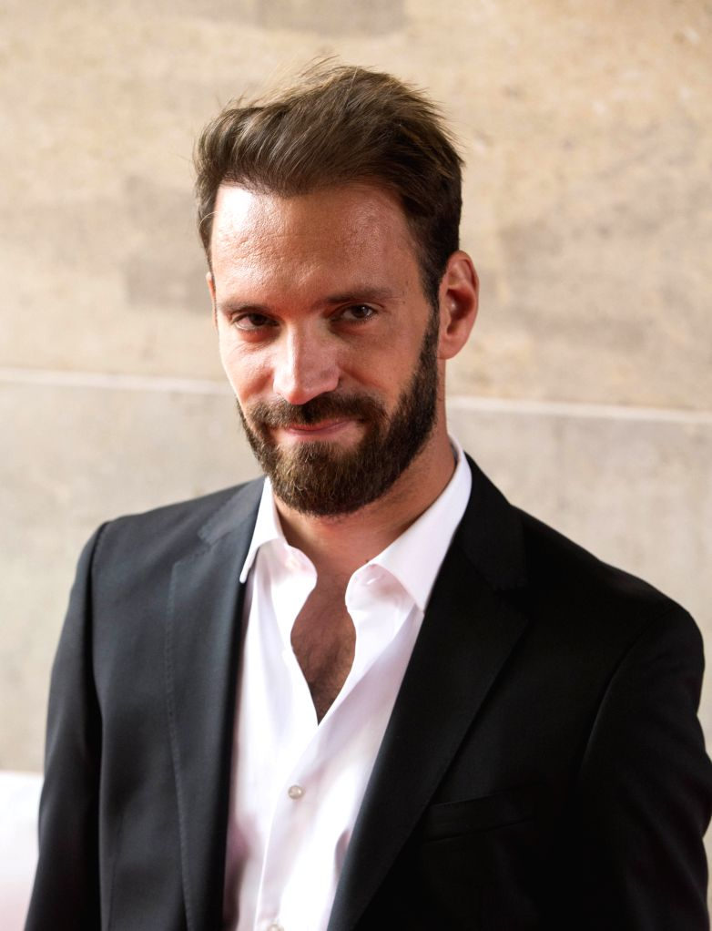 """TORONTO, Sept. 8, 2019 - Racing driver Jean-Eric Vergne poses for photos prior to the world premiere of the film """"And We Go Green"""" at the Ryerson Theater during the 2019 Toronto ..."""