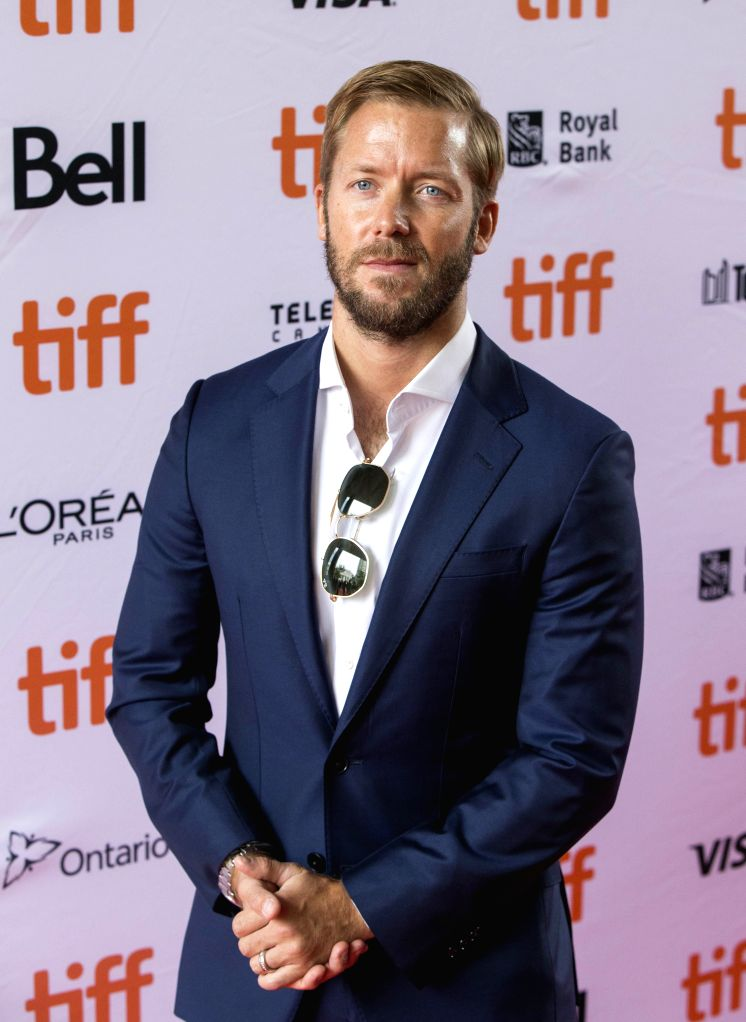 """TORONTO, Sept. 8, 2019 - Racing driver Sam Bird poses for photos prior to the world premiere of the film """"And We Go Green"""" at the Ryerson Theater during the 2019 Toronto International Film ..."""