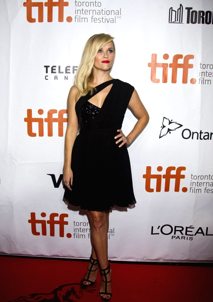 """Actress Reese Witherspoon poses for photos before the premiere of the film """"Wild"""" at Roy Thomson Hall during the 39th Toronto International Film Festival . - Reese Witherspoon"""