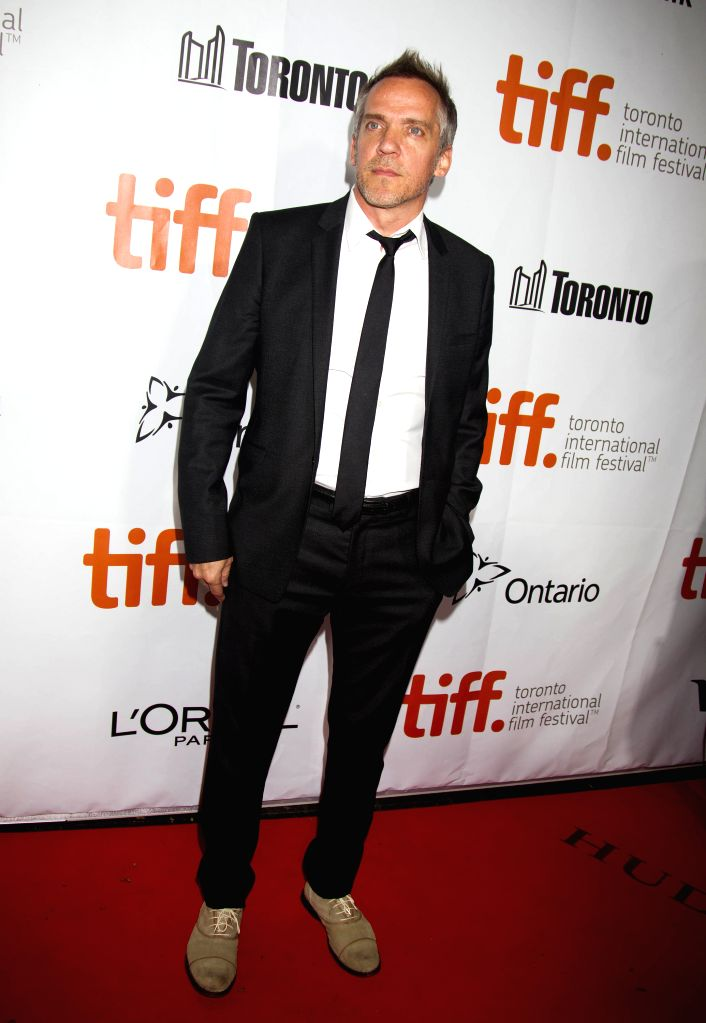 "Director Jean-Marc Vallee poses for photos before the premiere of the film ""Wild"" at Roy Thomson Hall during the 39th Toronto International Film Festival ."