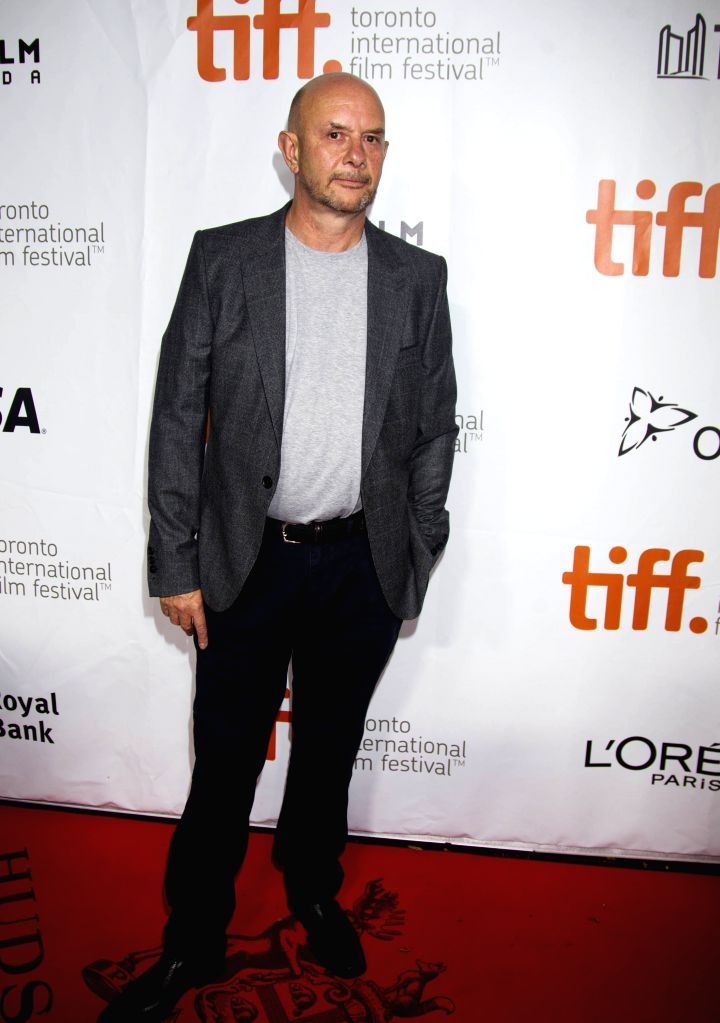 "Screenwriter Nick Hornby poses for photos before the premiere of the film ""Wild"" at Roy Thomson Hall during the 39th Toronto International Film Festival .."