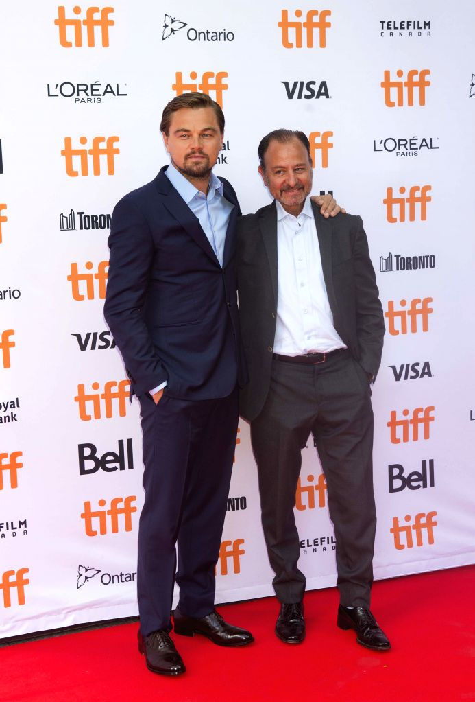 """TORONTO, Sept. 9, 2016 - Actor Leonardo DiCaprio(L) and director Fisher Stevens pose for photos before the world premiere of the documentary film """"Before the Flood"""" during the 41st Toronto ... - Leonardo D"""