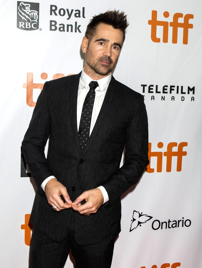 """TORONTO, Sept. 9, 2018 - Actor Colin Farrell poses for photos before the premiere of the film """"Widows"""" during the 2018 Toronto International Film Festival in Toronto, Canada, Sept. 8, 2018. - Colin Farrell"""