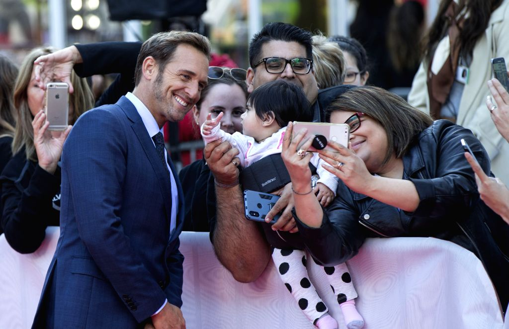 "TORONTO, Sept. 9, 2019 - Actor Josh Lucas (L, Front) poses for photos with fans  before the international premiere of the film ""Ford v Ferrari"" at Roy Thomson Hall during the 2019 Toronto ... - Josh Lucas"