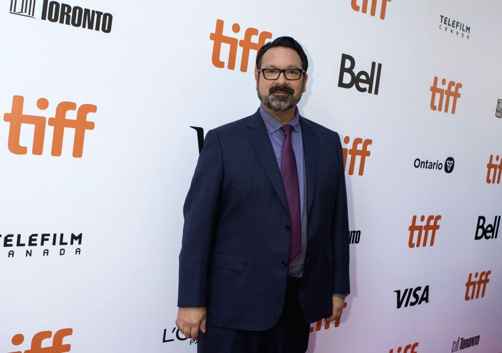 "TORONTO, Sept. 9, 2019 - Director James Mangold poses for photos before the international premiere of the film ""Ford v Ferrari"" at Roy Thomson Hall during the 2019 Toronto International ..."
