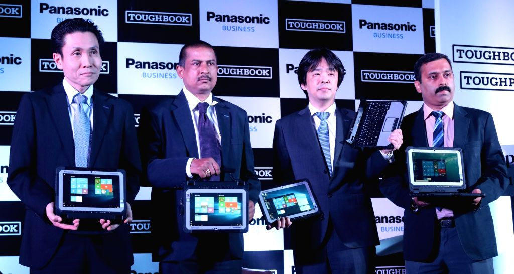 Toughbook General Ganager Nakanishi, Satyam solution director Rizhkant Zha, Panasonic India Head (Toughbook) Gunjan Sachdev and others at the launch of Toughbook in New Delhi, on June 23, ... - Rizhkant Zha