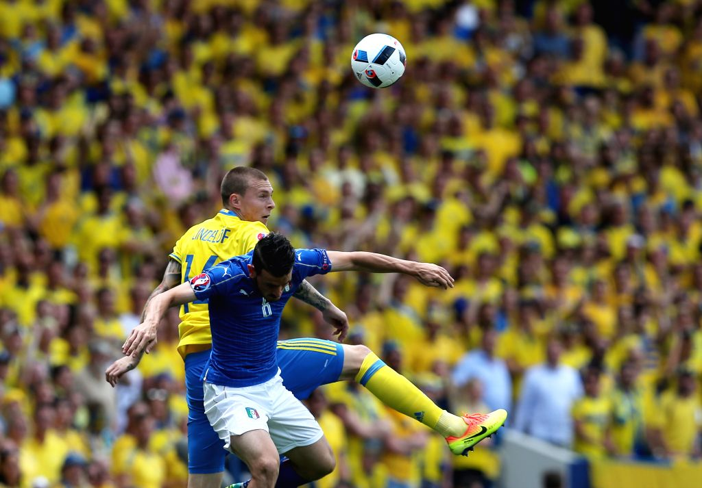 TOULOUSE, June 17, 2016 - Italy's Alessandro Florenzi (front) competes for a header with Sweden's Victor Lindelof during an Euro 2016 Group E soccer match between Italy and Sweden in Toulouse, ...