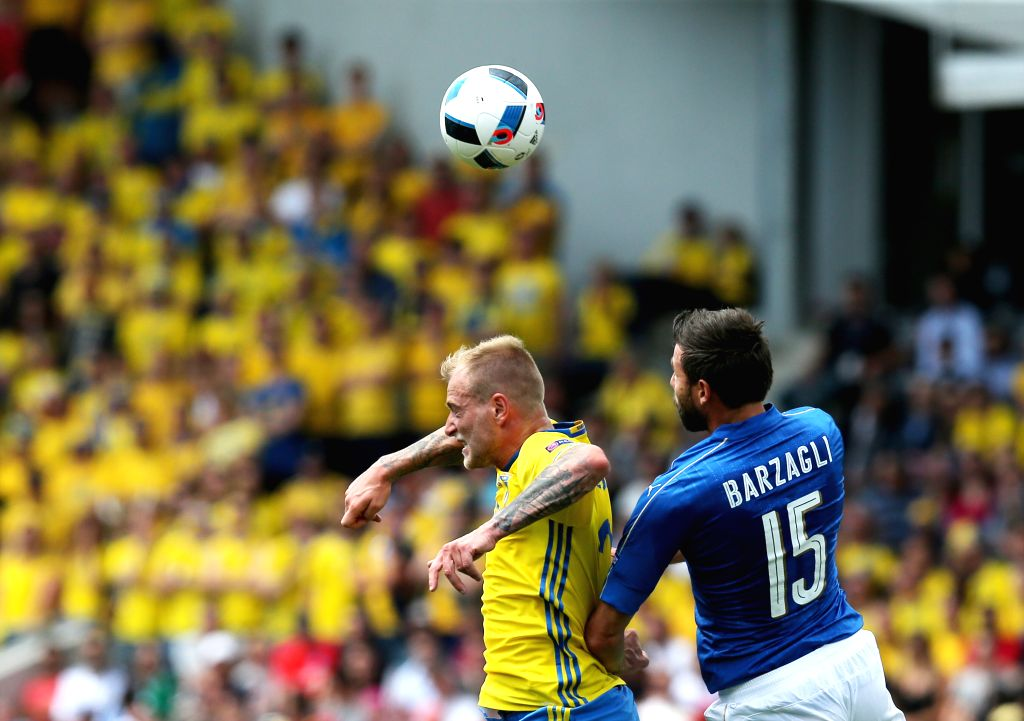 TOULOUSE, June 17, 2016 - Italy's Andrea Barzagli (R) competes for a header with Sweden's John Guidetti during an Euro 2016 Group E soccer match between Italy and Sweden in Toulouse, France, June 17, ...