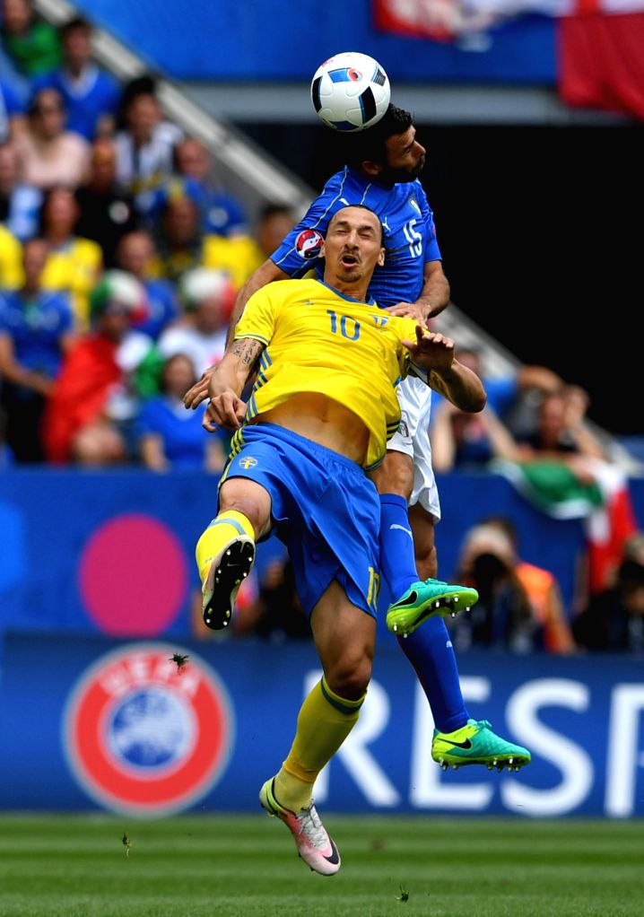 TOULOUSE, June 17, 2016 - Sweden's Zlatan Ibrahimovic (front) heads for the ball with Italy's Andrea Barzagli during their UEFA Euro 2016 group E match at the Stadium Municipal in Toulouse, France, ...