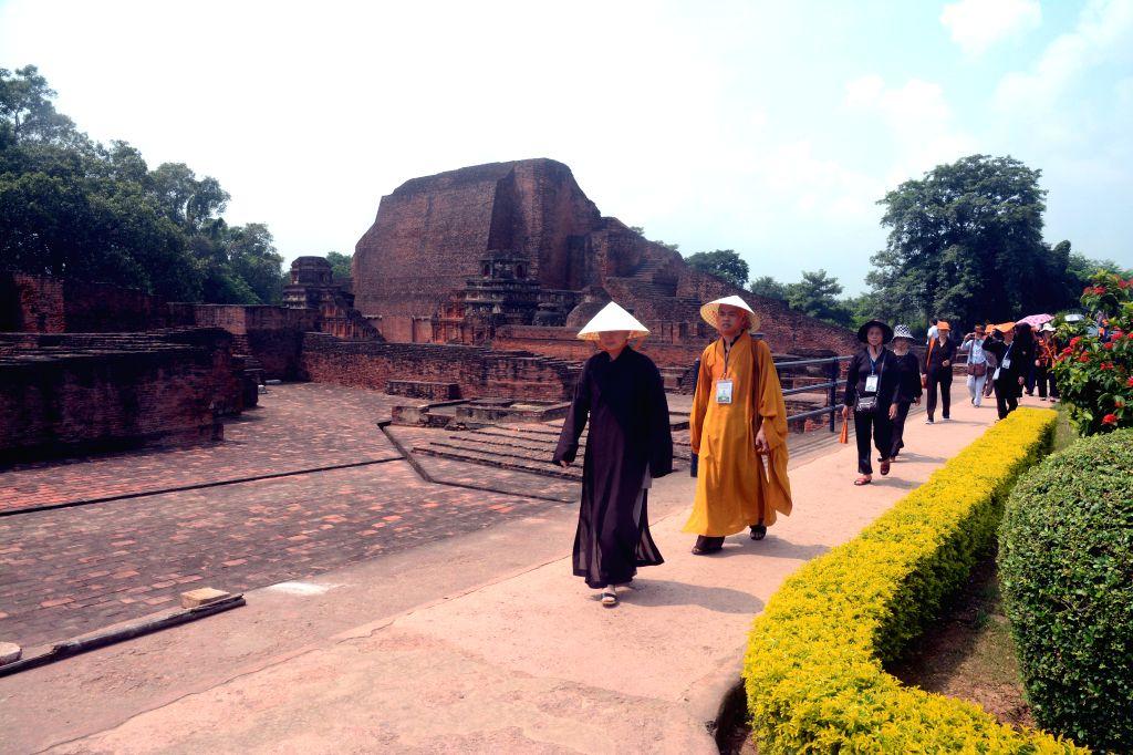 Tourist visiting the ruins of Ancient Nalanda University at Rajgir, Bihar on Sept. 19, 2014. (Photo: IANS)