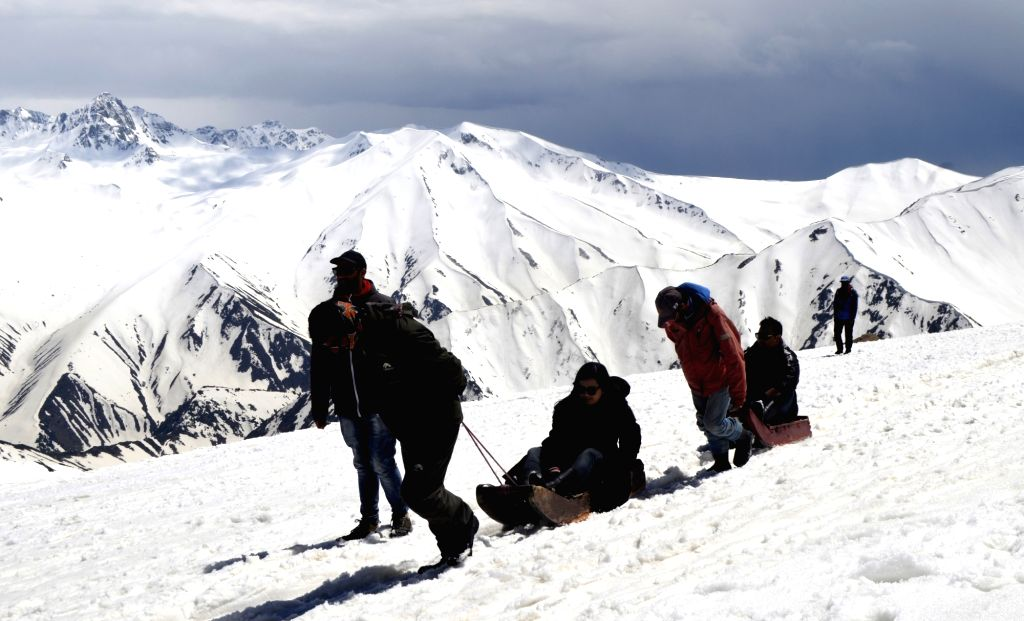 Tourists enjoy sledge ride in Jammu and Kashmir's Gulmarg, on May 5, 2019.