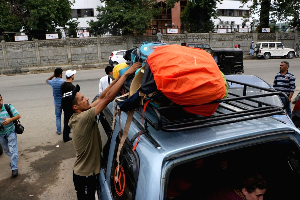 """Tourists leave Srinagar after the state government on Friday advised the tourists and Amarnath Yatris that """"they may curtail their stay in the Valley immediately and take necessary ..."""
