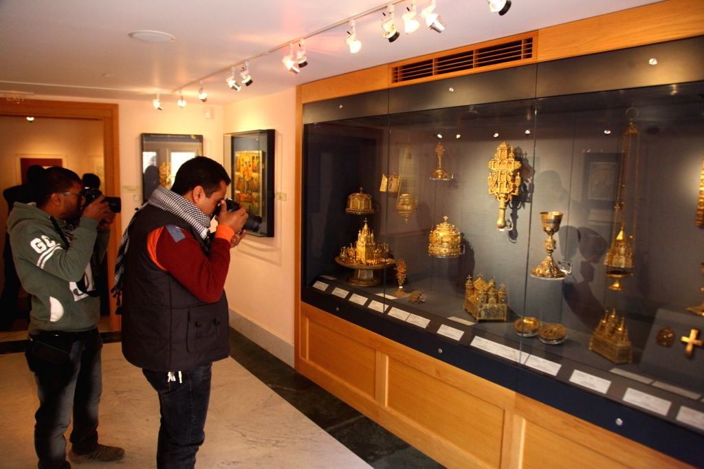 Tourists take photos of historical relics at Saint Catherine's museum in south Sinai, Egypt, Jan. 16, 2016. The monastery is one of the oldest working Christian ...