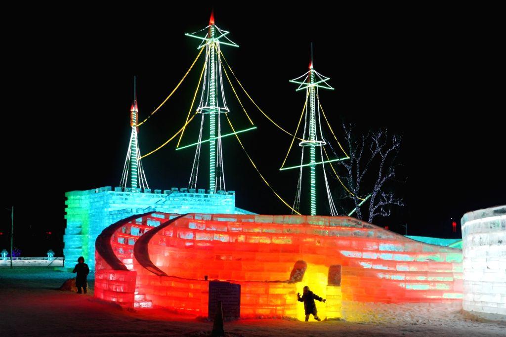 Tourists visit Changchun ice and snow grand world at Lianhua Mountain holiday resort in Changchun, northeast China's Jilin Province, Jan. 9, 2020. Changchun ice ...