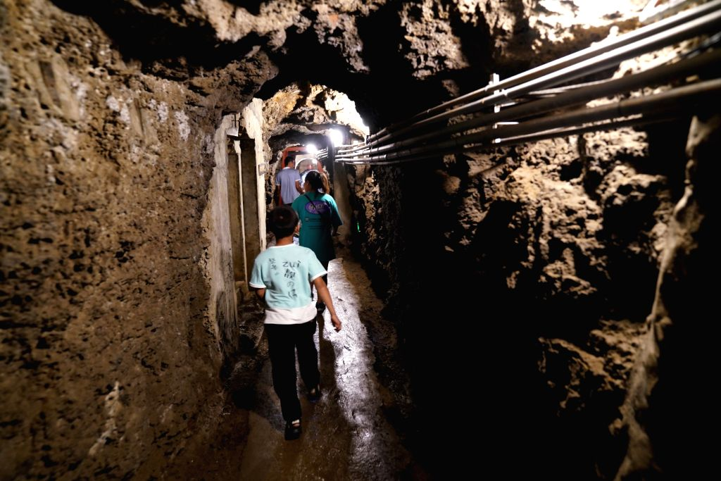 Tourists visit the historic site of Xunshan fort at Dongning Fortress tourist spot in Dongning, northeast China's Heilongjiang Province, Aug. 13, 2020. Dongning ...