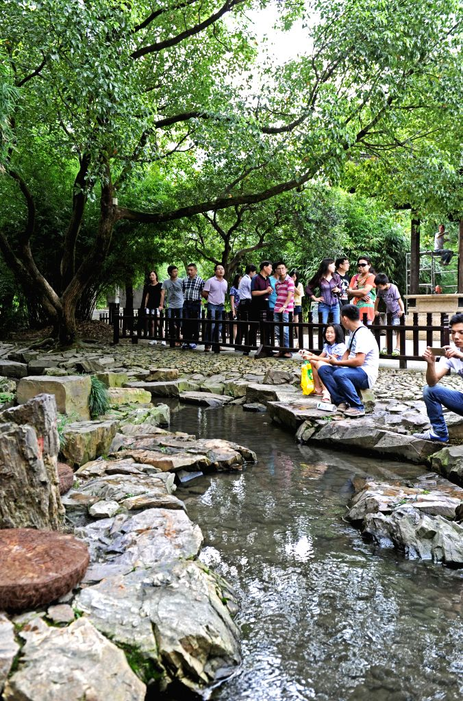 Tourists visit the Lanting scenic area in Shaoxing, east China's Zhejiang Province, August 25, 2015. According to the latest figures issued by the Zhejiang Tourism ...