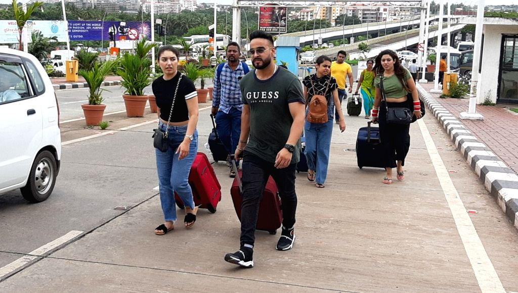 Tourists walk in search of other means of transport at Dabolim Airport during Goa taxi strike, on Aug 2, 2019. Thousands of taxis went off the roads in Goa on Friday in protest against the ...