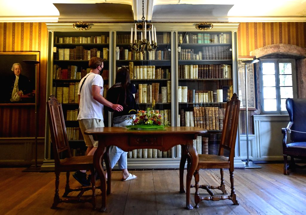 Tourists wearing face masks visit the Goethe House, where the German world-renowned poet and playwright Johann Wolfgang Goethe was born and raised, in Frankfurt, ...