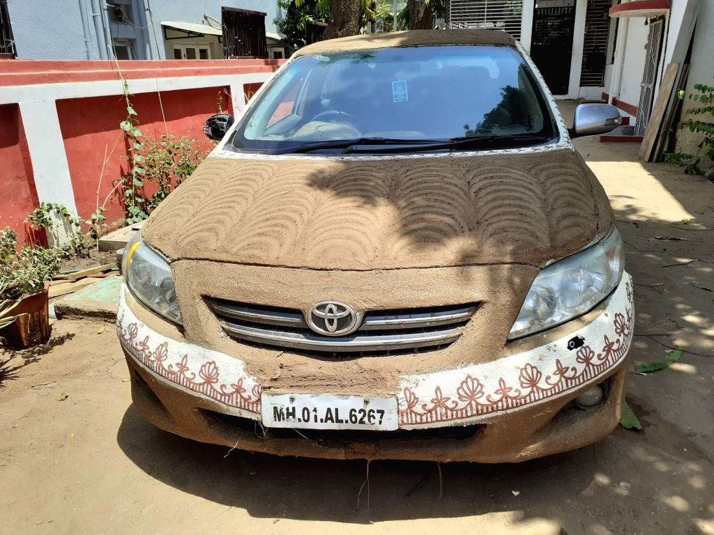 Toyota Corolla Altis painted all over by cow dung.