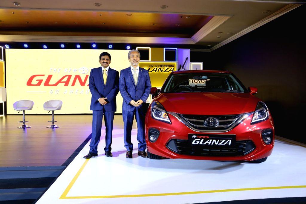Toyota Kirloskar Motor MD Masakazu Yoshimura and Deputy Managing Director N. Raja at the launch of Toyota Glanza, in New Delhi on June 6, 2019.