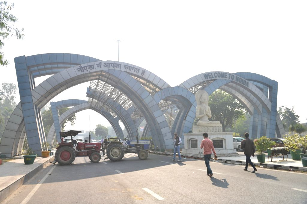 Tractors seen parked at the Noida-Delhi border during farmers' protest against the Central Government's new Farm Laws, on Dec 2, 2020.